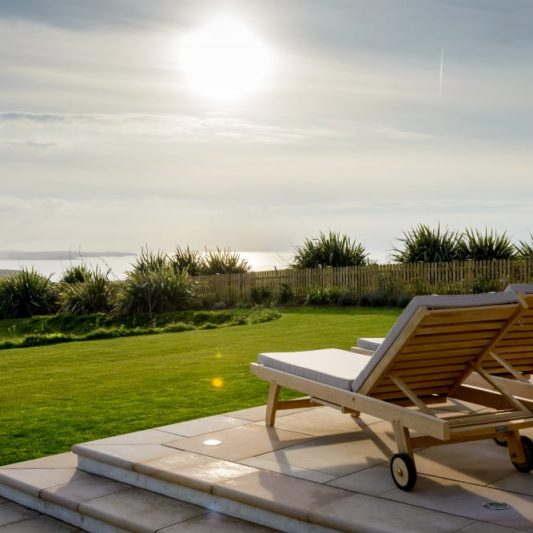 Sun loungers in garden at Panorama, Mawgan Porth