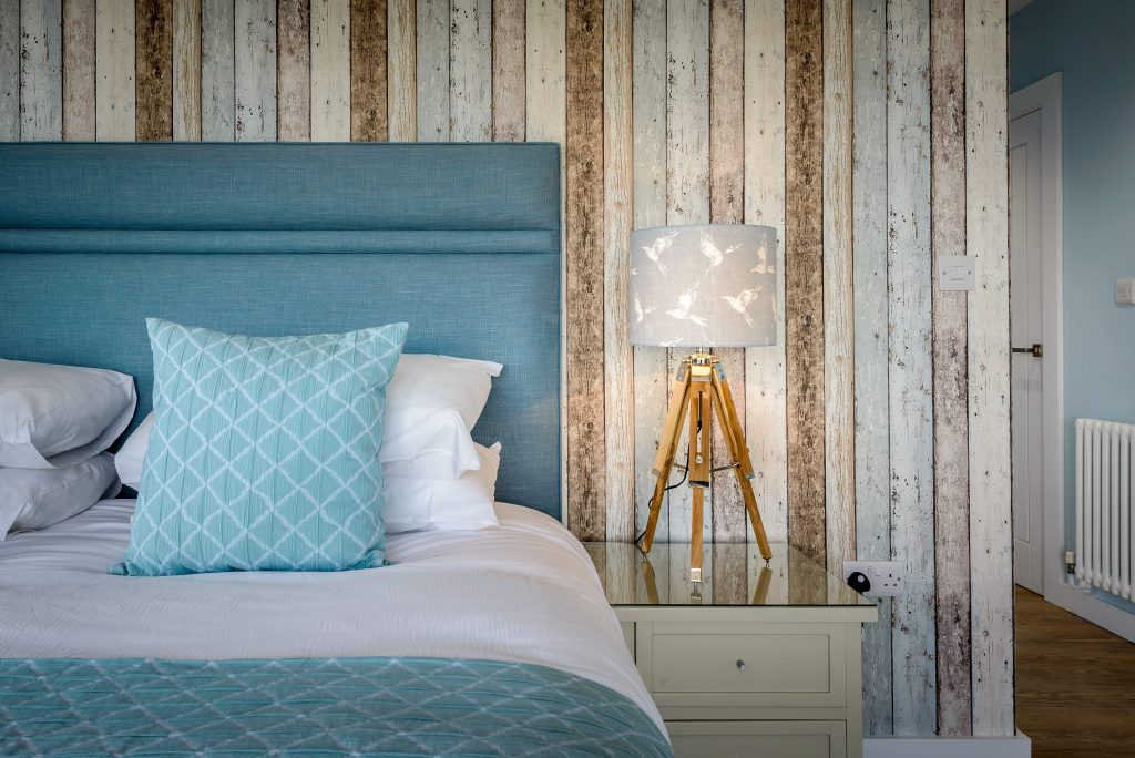 Interior designed bedroom in wood and teal, Panorama Mawgan Porth
