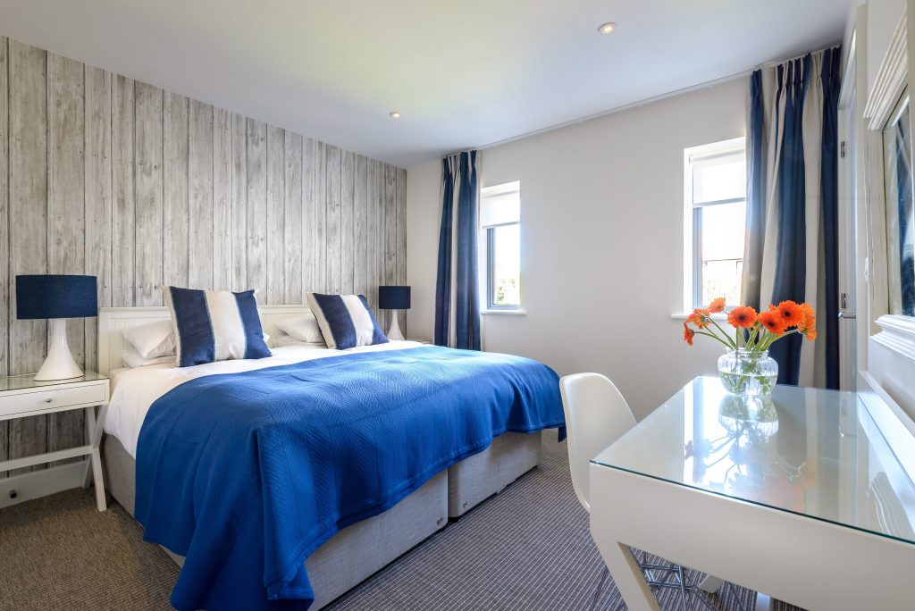 Interior designed bedroom with blue soft furnishings at Seamist, Watergate Bay