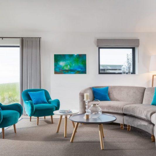Interior designed living space. Artwork from Whistlefish, sofa from sofa.com