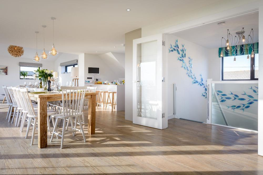 Interior designed dining space by Tracey Mannell at Panorama Mawgan Porth