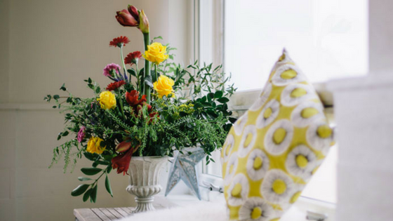 Flower bouquet in vase on window sill