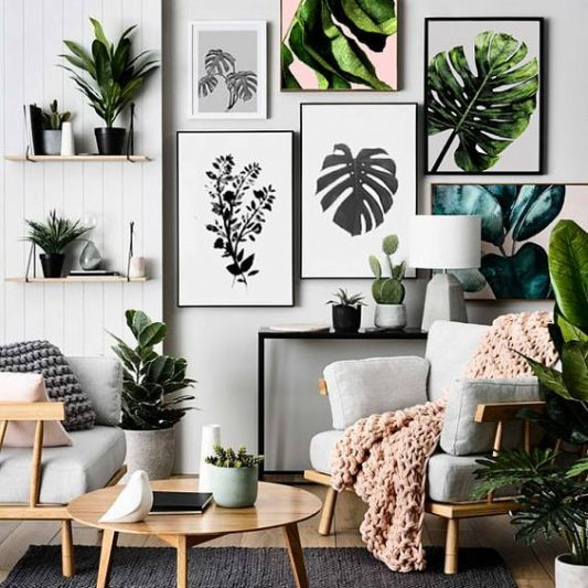 Natural interior design with leaf print artwork gallery on wall