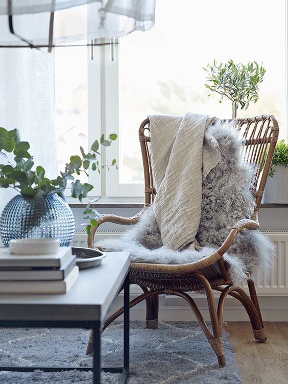 Rattan chair with fur rug in living space