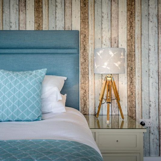 Master bedroom with a relaxed coastal vibe
